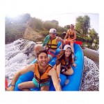 Selfie stick picture while white water rafting
