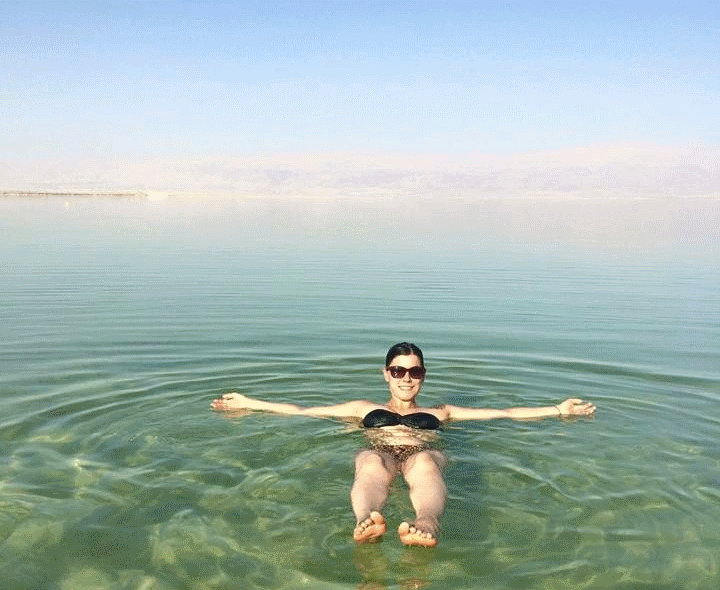 Girl Floating in the Dead Sea