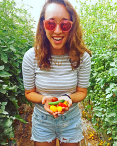 Emma with cherry tomatoes